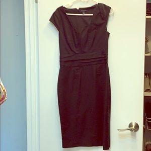 Knee length dress.